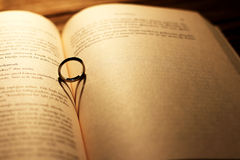 Heart shadow with ring on a book middle - write your text. On the right Royalty Free Stock Photos
