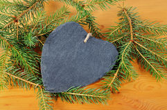 Heart from shale with fir tree branch Stock Photography