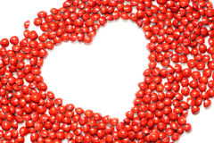 Heart shape. Red seeds with a heart shape stock photography