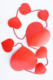 Heart shape. Pendant of red hearts with the beads during the day of saint Valentina Stock Photos