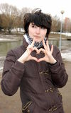 Heart shape. Emo girl depicts the heart as hands Royalty Free Stock Photo