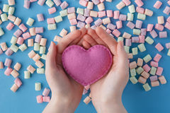Heart shape against sweet colored marshmallow on blue background Stock Images