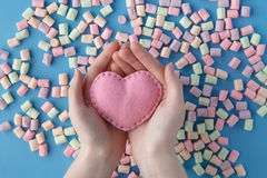 Heart shape against sweet colored marshmallow on blue background Royalty Free Stock Image