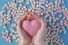 Heart shape against sweet colored marshmallow on blue background Royalty Free Stock Photo