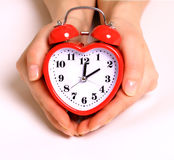 Heart shape alarm clock Stock Photo