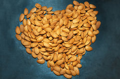 Heart shape from almond nuts texture Stock Images