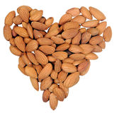 Heart shape from almonds nuts isolated on white. Royalty Free Stock Photos
