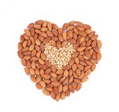 Heart shape of almonds and pine nuts. Royalty Free Stock Images