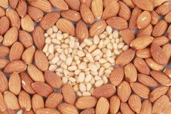 Heart shape of almonds and pine nuts. Royalty Free Stock Photography