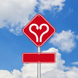 Heart shape with arrow road sign Stock Images