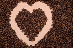 Heart shape background made with coffee beans Stock Photos