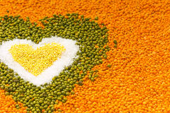 Heart shape background made of mixed wheat grains, white salt, g Royalty Free Stock Photos