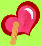 Heart Shape and Band-Aid Royalty Free Stock Photo