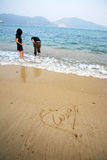 Heart shape on beach Stock Photography