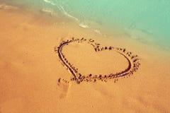Heart shape on beach sand Stock Photo
