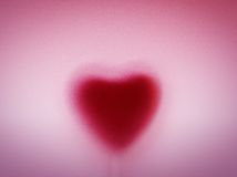 Heart shape behind milky frosted glass. Love, romantic background Stock Images