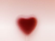 Heart shape behind milky frosted glass Stock Image
