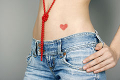 Heart shape on the belly Stock Photography