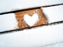 Heart shape on the bench (1). Heart shape on the bench, formed with snow Royalty Free Stock Photos