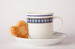Heart shape biscuit. Cup of coffee with heart butter biscuit Royalty Free Stock Photos