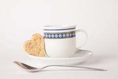 Heart shape biscuit. Cup of coffee with heart butter biscuit Stock Photo