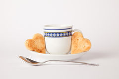 Heart shape biscuit. Cup of coffee with heart butter biscuits Stock Photos