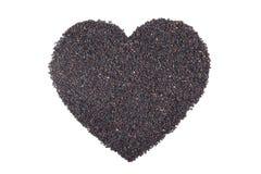 Heart shape of black sesame seeds Stock Image