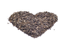 Heart shape black tea Royalty Free Stock Images