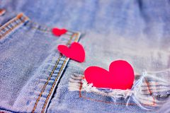 Heart shape with blue jeans. Blue jeans and three pink heart shape Royalty Free Stock Photography