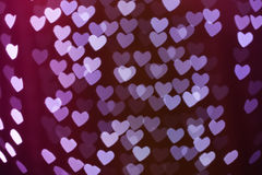 Heart shape blurred bokeh background. Heart shaped holiday blurred bokeh background. Valentine background. Christmas background. Horizontal Stock Photos