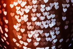 Heart shape blurred bokeh background. Heart shaped holiday blurred bokeh background. Valentine background. Christmas background. Horizontal Stock Images