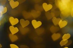 Heart shape bokeh background. Floating gold heart shape bokeh background royalty free stock images