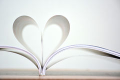Heart shape of book pages, Love book. Stock Photos