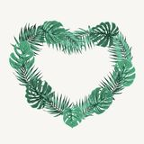 Heart shape border frame green tropical leaves Stock Photography