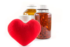Heart shape and bottles of pill Stock Image