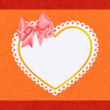 Heart shape with a bow on textile Stock Photo