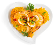 Heart shape bowl with paella Stock Photography