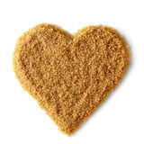 Heart shape of brown sugar Royalty Free Stock Images