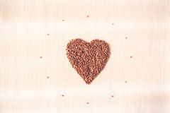 Heart shape of buckwheat cereals Royalty Free Stock Photography