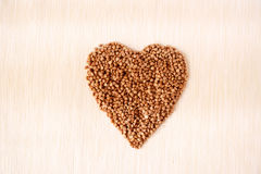 Heart shape of buckwheat cereals Royalty Free Stock Photos