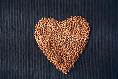 Heart shape of buckwheat cereals Royalty Free Stock Image