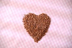 Heart shape of buckwheat cereals Stock Photos