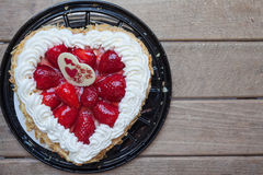 Heart shape cake with Strawberry. And almond, gift for Valentines Day. With wooden background, copy space available Stock Photo