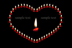 Heart shape with candle. Heart shape made from candlelight  on  background Royalty Free Stock Image