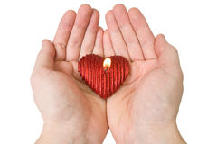 Heart-shape candle in a hands Stock Photography