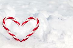 Heart Shape Candy Canes in the Snow Stock Images