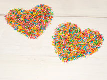 Heart-shape from candy confetti Stock Photos