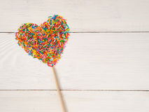 Heart-shape from candy confetti Royalty Free Stock Photography