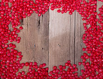 Heart shape candy on wooden plank Stock Photo