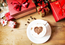 Heart Shape Cappuccino Cup with Whipped Cream and Wrapped Gifts Royalty Free Stock Image